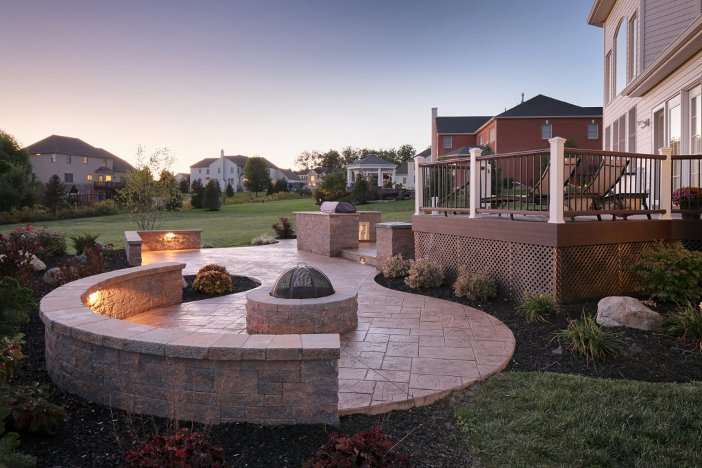 Landscape lighting surrounds fire pit