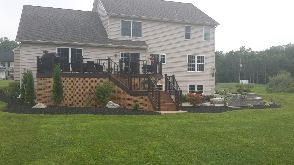 A deck and patio with landscaping