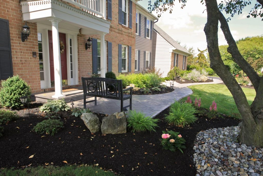A front walkway and landscaping create curb appeal