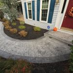 A stamped concrete walkway and steps