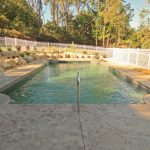 Stamped concrete surrounds a pool