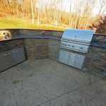 A large L shaped outdoor kitchen