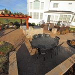A patio and deck with outdoor amenities